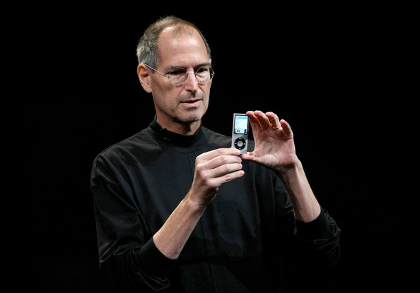Steve Jobs holding an iPod