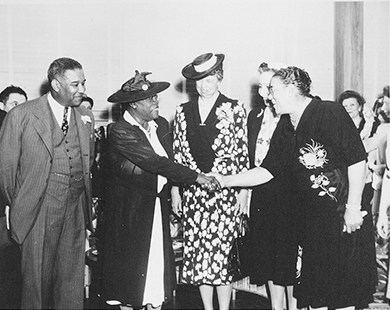 A photograph depicts Mary McLeod Bethune, Eleanor Roosevelt, and several others at the opening of Midway Hall.