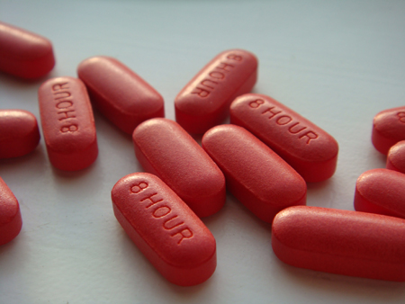 This photo shows several red capsule pills.