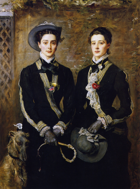 A portrait of twins wearing traditional hunting gear is shown.