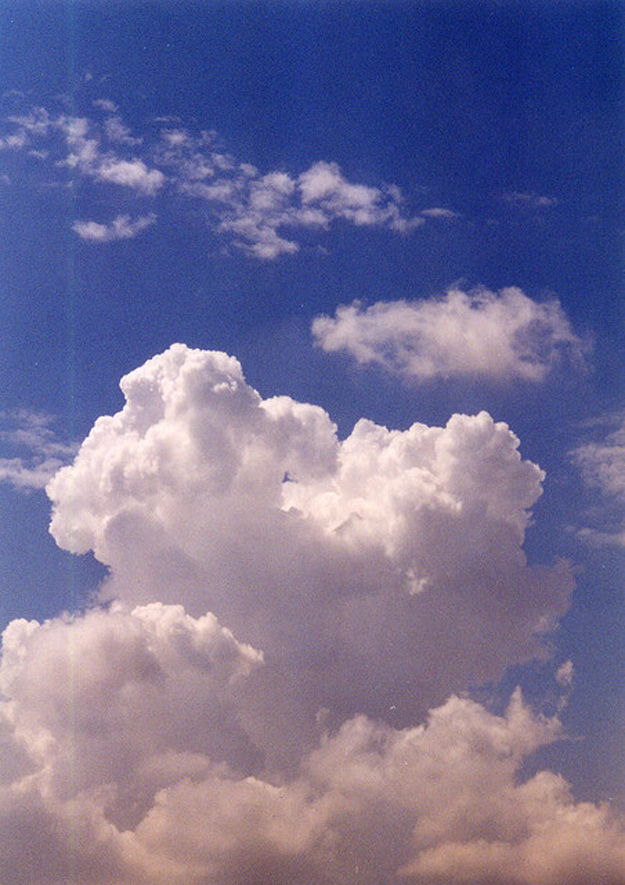 The figure shows a cumulus cloud in a blue sky.