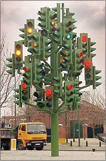 A traffic signal with dozens of lights pointing in all directions.