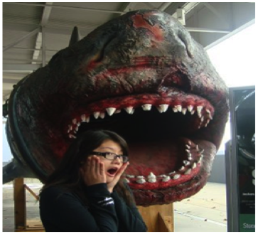A portrait of the author in front of a fake shark.