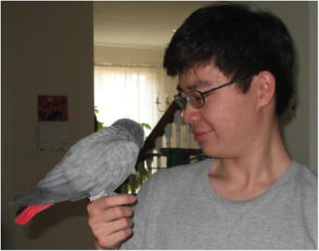 a photo of the author hodling a bird.