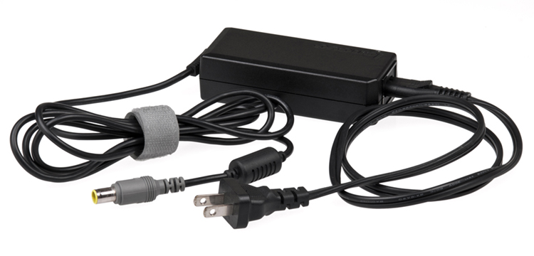 This black power charging unit connects a laptop to an electrical outlet, allowing the laptop to be charged up.