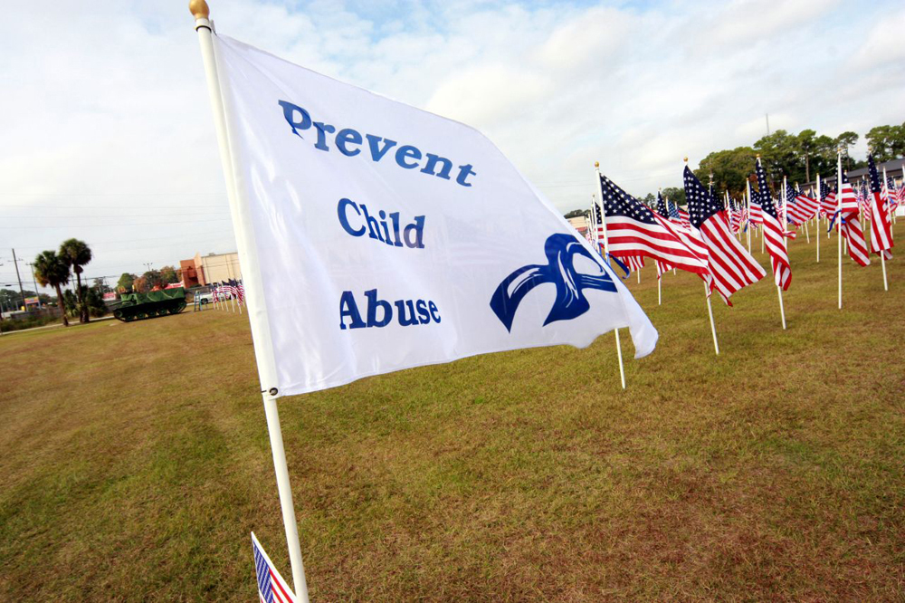 A flag with the words Prevent Child Abuse on it.