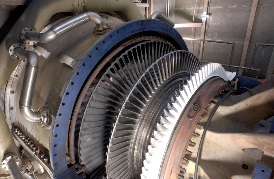 Photograph of a steam turbine connected to a generator.