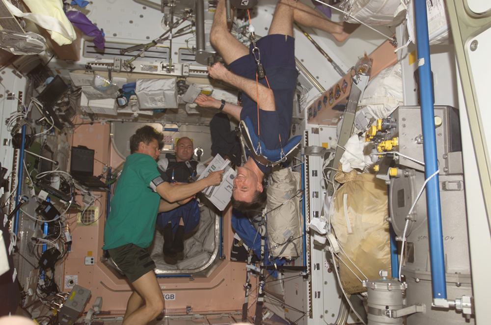 The figure shows some astronauts floating inside the International Space Station