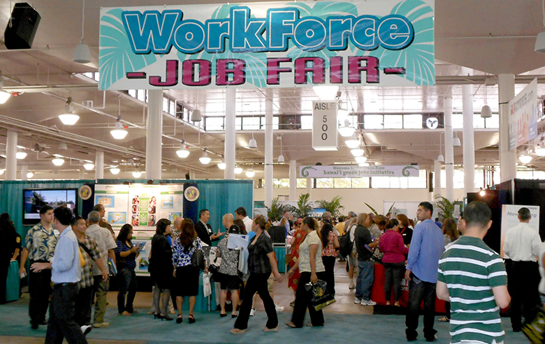 This is a photograph of people at a job fair.