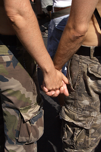 A photograph shows two people holding hands.