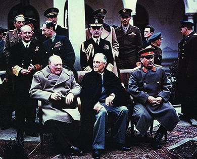 A photograph shows Winston Churchill, Franklin Roosevelt, and Joseph Stalin seated together at Yalta, surrounded by officials and military.