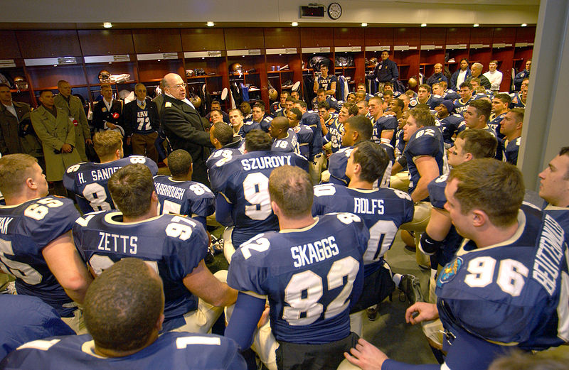 This is a picture of the U.S. Naval Academy's football team in their locker room.