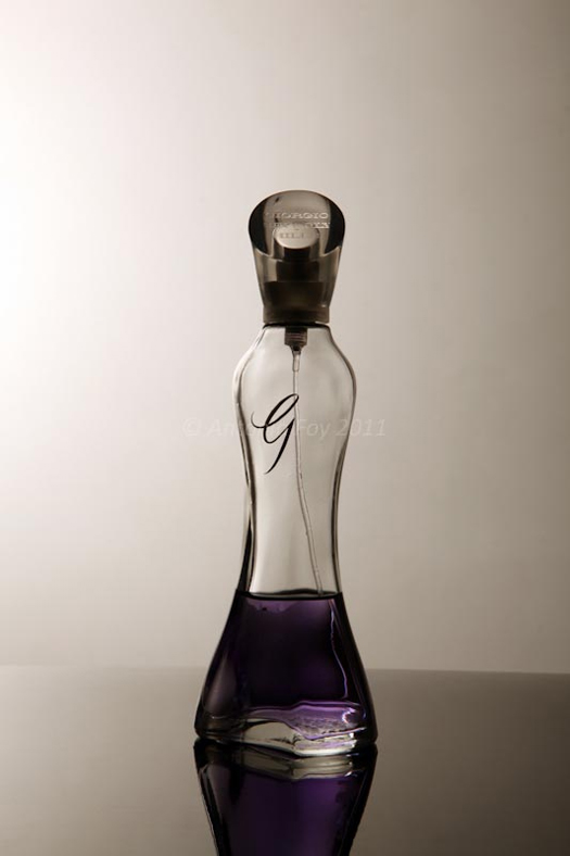 A perfume bottle with a spray cap.