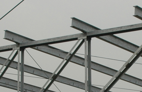 Figure is a photograph of steel I-beams are used in construction.